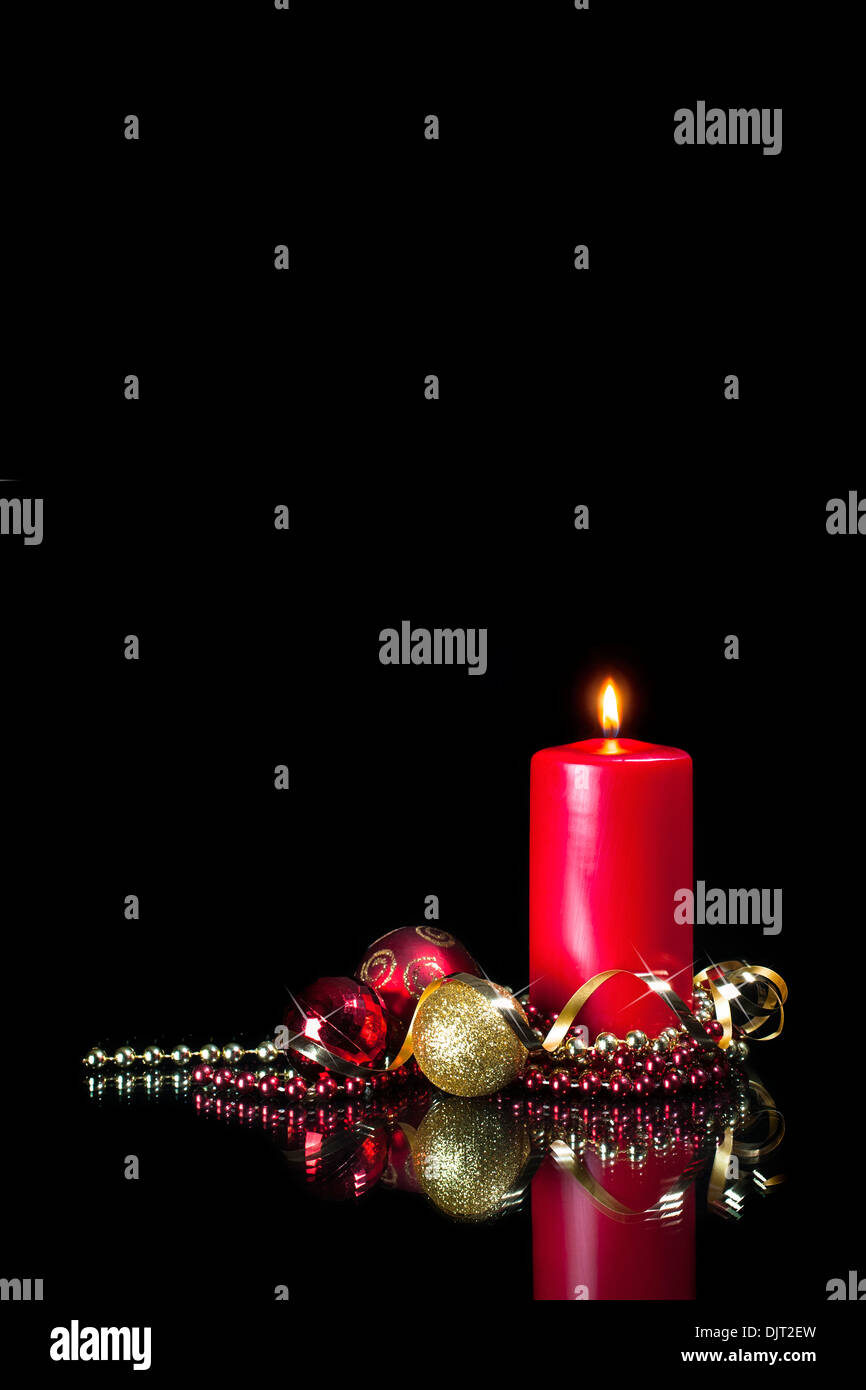 Christmas card picture - red candle and decorations Stock Photo