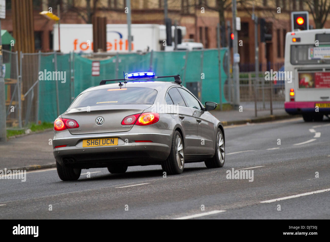 Unmarked Police car Strathclyde police UK speeding to a scene with blue lights flashing. Glasgow, Scotland, UK Stock Photo