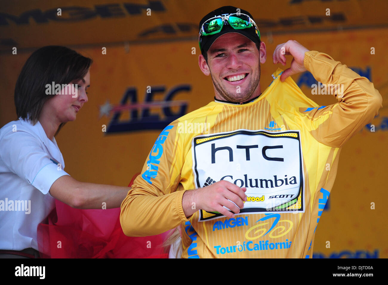 Mark Cavendish of Team HTC-Columbia is all smiles as he dons the race leader 958d1ca92
