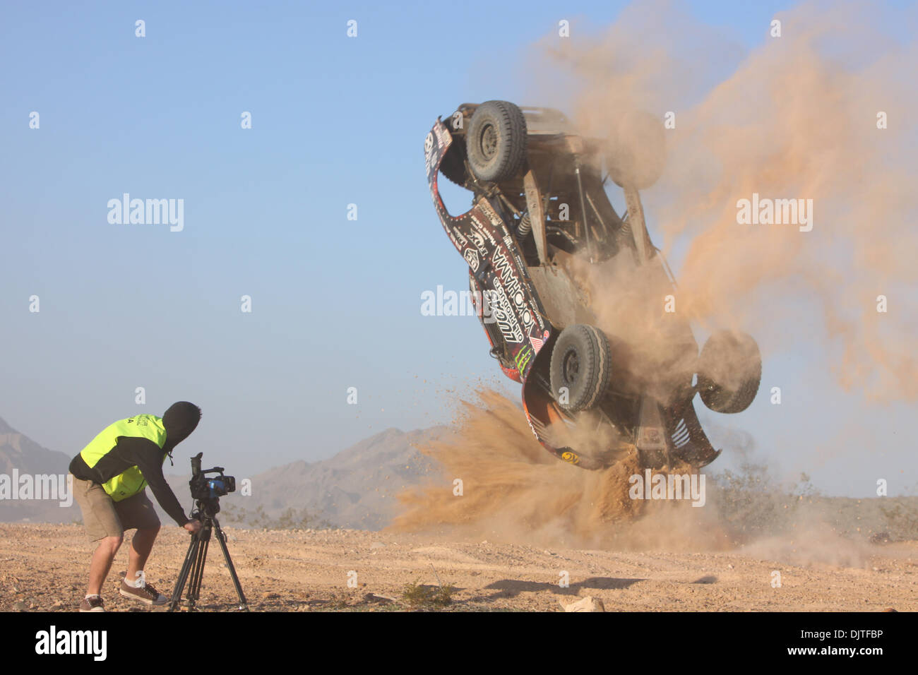 March 27, 2010 Videographer Scott Smith gets a front row seat to #1 Cameron Steele's spectacular end over end crash during qualifying at the SNORE, Mint 400 off-road race outside Las Vegas Nevada. (Credit Image: © Mike Ingalsbee/Southcreek Global/ZUMApress.com) - Stock Image