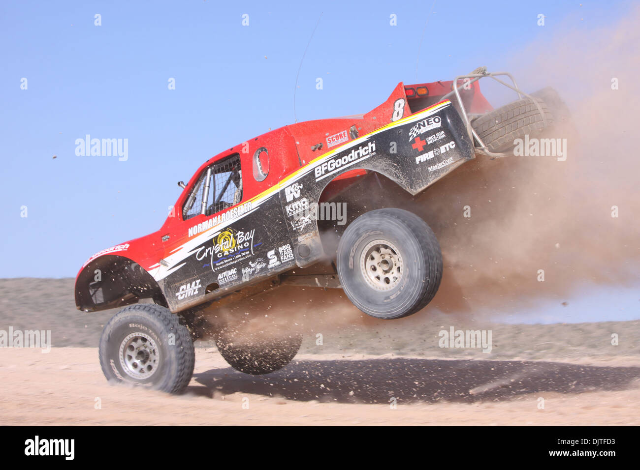 March 27, 2010 Roger Norman (#8) Launches high off a jump trailing dirt behind then lands hard in the dirt during qualifying at the SNORE, Mint 400 off-road race outside Las Vegas Nevada. (Credit Image: © Mike Ingalsbee/Southcreek Global/ZUMApress.com) - Stock Image