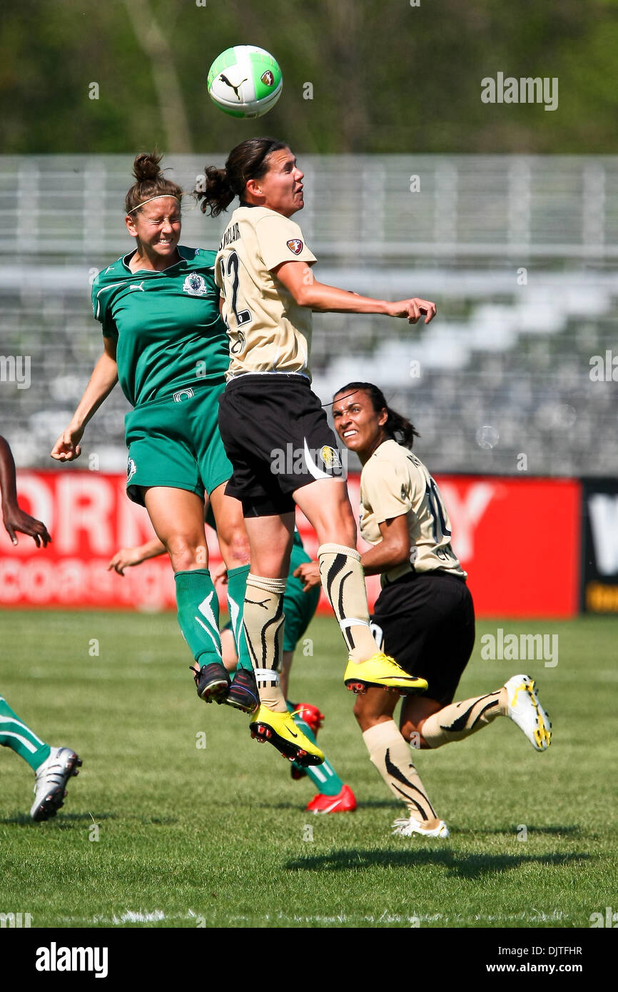11 April 2010:  FC Gold Pride forward Christine Sinclair (12) beats Athletica midfielder Carolyn Blank (3) to the header while FC Gold Pride forward Marta (10) looks on. The Saint Louis Athletica defeated FC Gold Pride 2-0 in their 2010 home opener at Anheuser-Busch Soccer Park in Fenton, Missouri on April 11th 2010.  Mandatory Credit - Scott Kane / Southcreek Global. (Credit Image - Stock Image