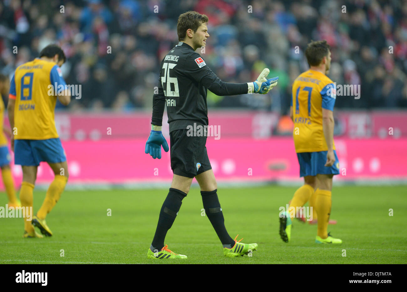 Munich, Germany. 30th Nov, 2013. Braunschweig's Deniz Dogan (L), goalkeeper Daniel Davari (C) and Kevin Kratz reacts after Munich's 2-0 goal during the German Bundesliga match between FC Bayern Munich and Eintracht Braunschweig at Allianz Arena in Munich, Germany, 30 November 2013. Photo: ANDREAS GEBERT (ATTENTION: Due to the accreditation guidelines, the DFL only permits the publication and utilisation of up to 15 pictures per match on the internet and in online media during the match.)/dpa/Alamy Live News - Stock Image