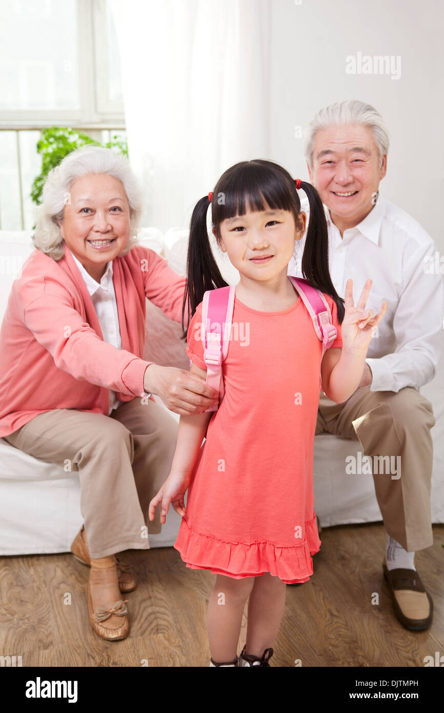 Senior couple with granddaughter - Stock Image