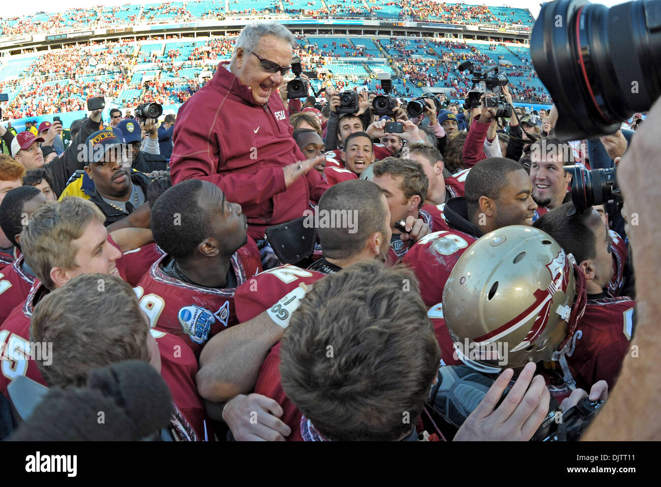 NCAA Gator Bowl - Bobby Bowden is carried off the field by his team after FSU upset West Virginia in the 2010 Gator Stock Photo