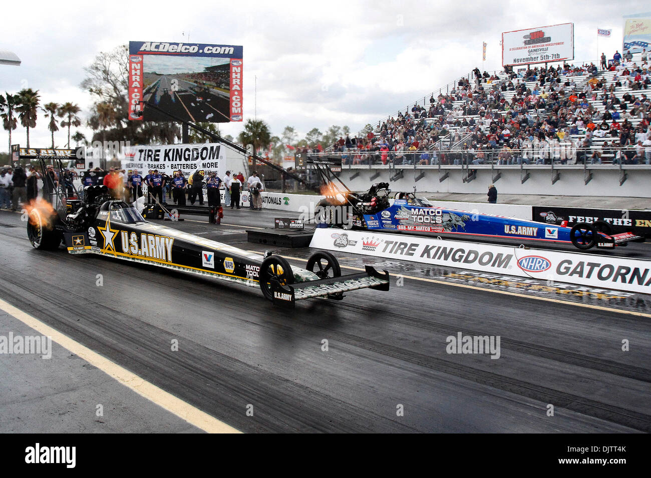 NHRA Top Fuel driver Tony Schumacher (L) beats Antron Brown