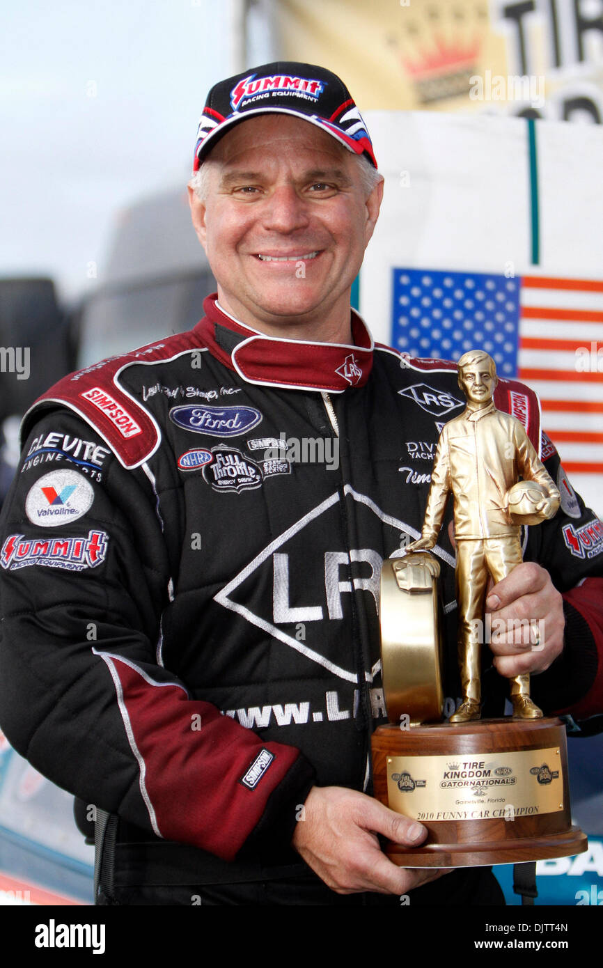 NHRA Funny Car driver Tim Wilkerson is all smiles after