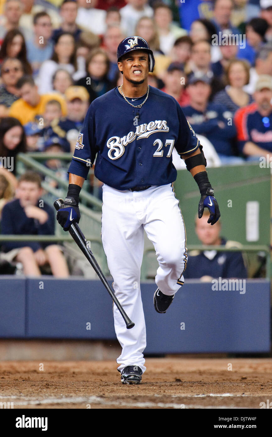Milwaukee Brewers center fielder Carlos Gomez (27) grimaces in pain after hitting a foul ball off of his left foot during the game between the St. Louis Cardinals and Milwaukee Brewers at Miller Park in Milwaukee.  The Cardinals defeated the Brewers 7-1. (Credit Image: © John Rowland/Southcreek Global/ZUMApress.com) - Stock Image