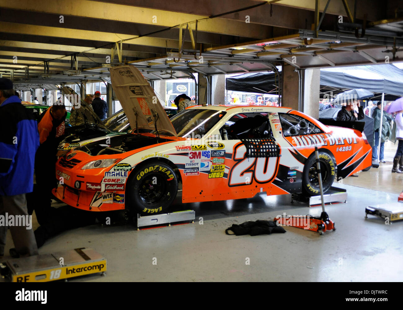 The 20 Home Depot Car Of Joey Logano In The Garage During A Rain