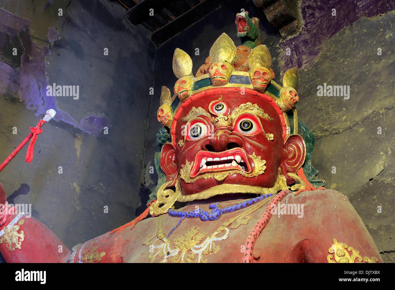 Statue of guardian god, Sakya Monastery, Shigatse Prefecture, Tibet, China - Stock Image