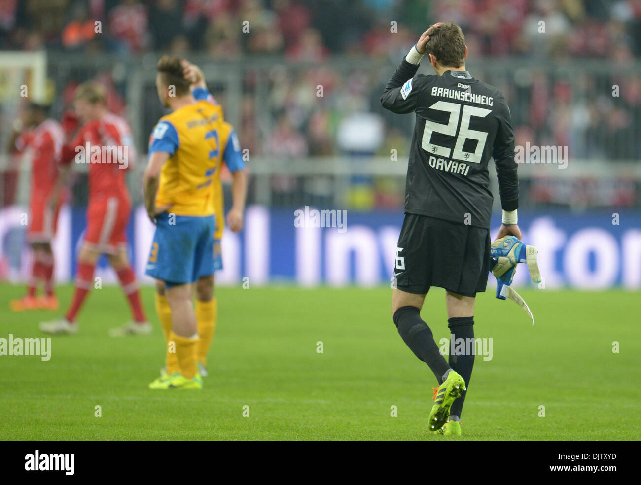 Munich, Germany. 30th Nov, 2013. Braunschweig's goalkeeper Daniel Davari walks across the pitch after the German Bundesliga match between FC Bayern Munich and Eintracht Braunschweig at Allianz Arena in Munich, Germany, 30 November 2013. Photo: ANDREAS GEBERT (ATTENTION: Due to the accreditation guidelines, the DFL only permits the publication and utilisation of up to 15 pictures per match on the internet and in online media during the match.)/dpa/Alamy Live News - Stock Image