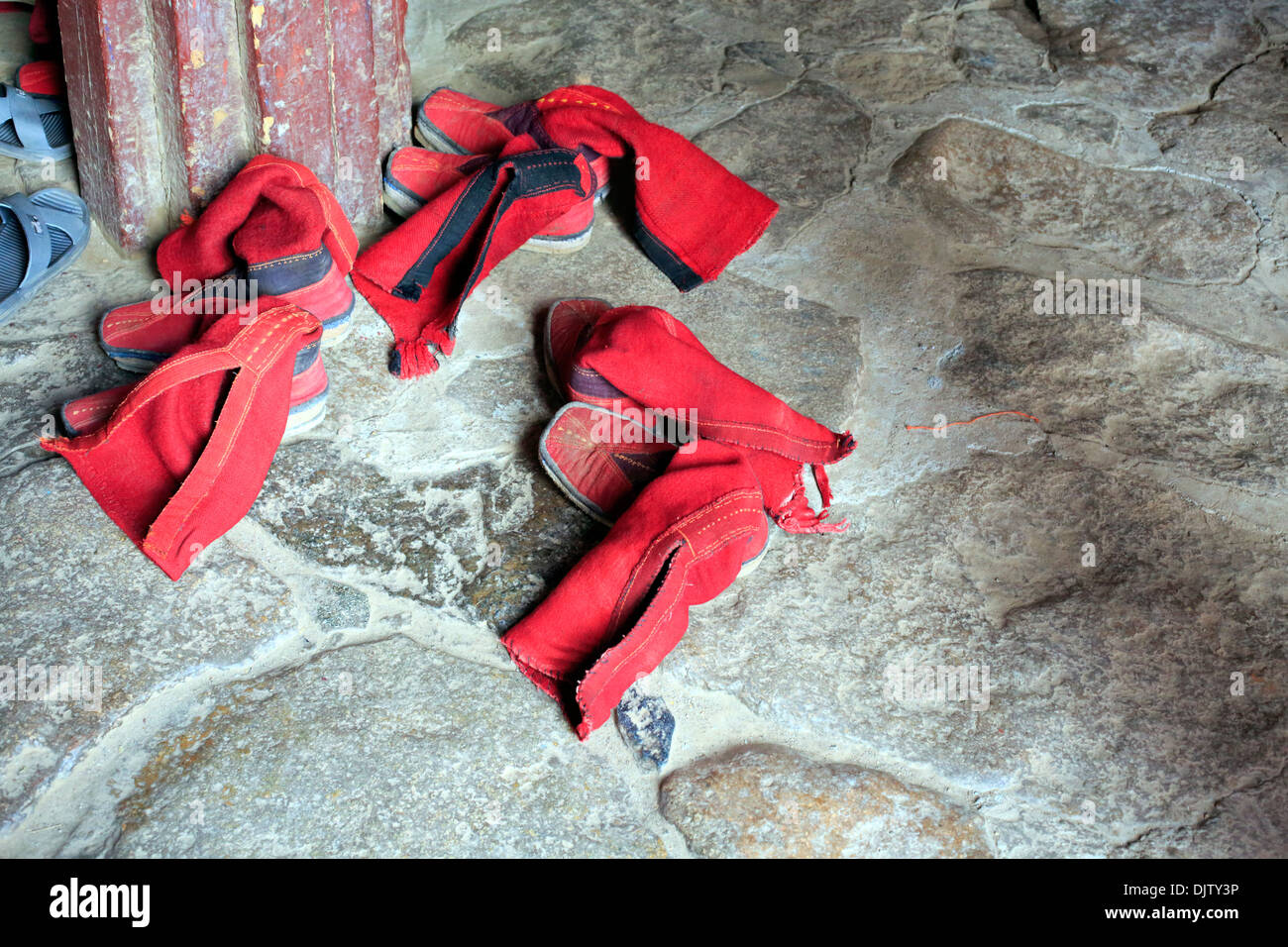 Footwear at the temple entrance, Shalu Monastery, Shigatse, Tibet, China - Stock Image