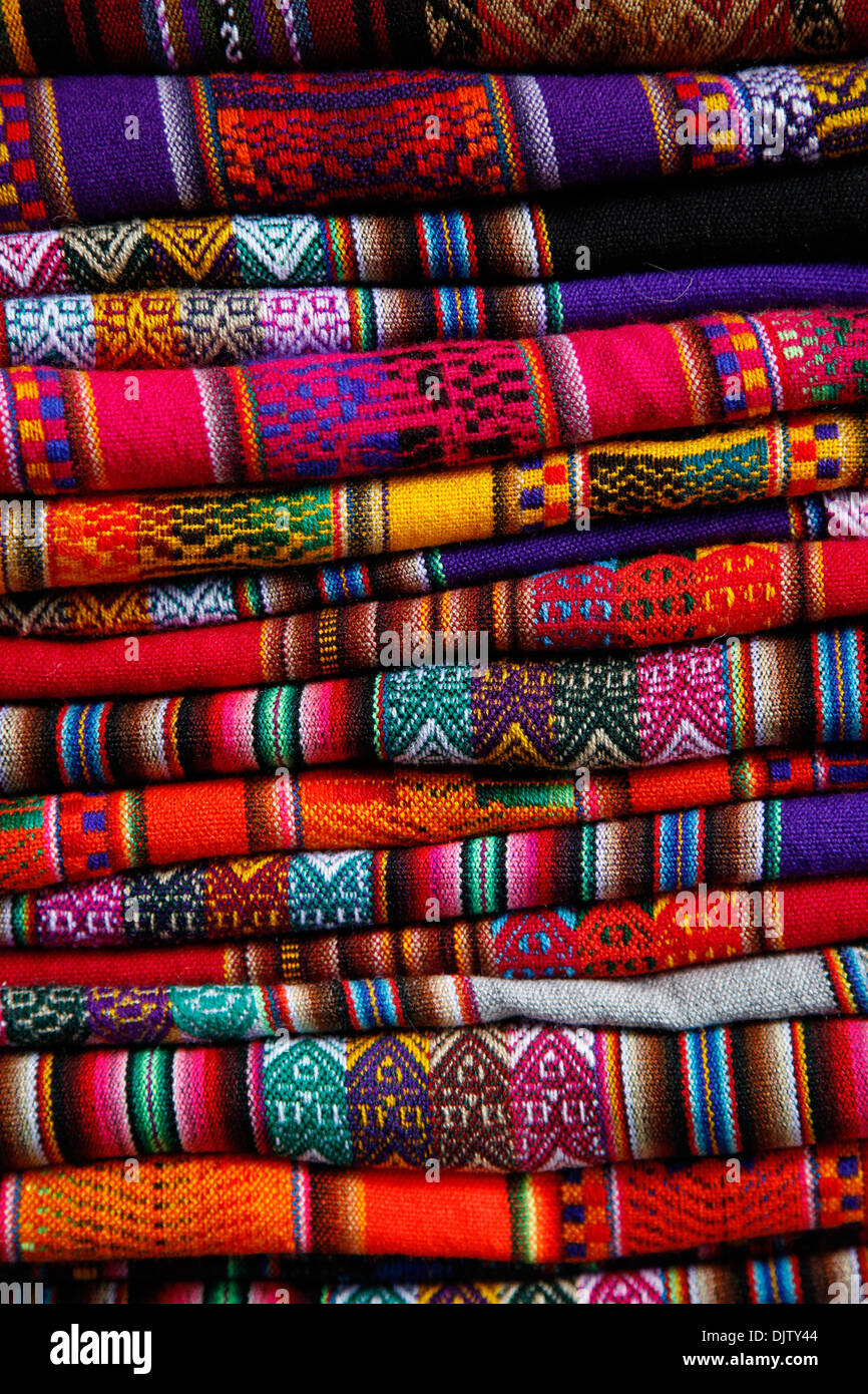 Local carpets made of llama and alpaca wool for sale at the market, Cuzco, Peru. - Stock Image