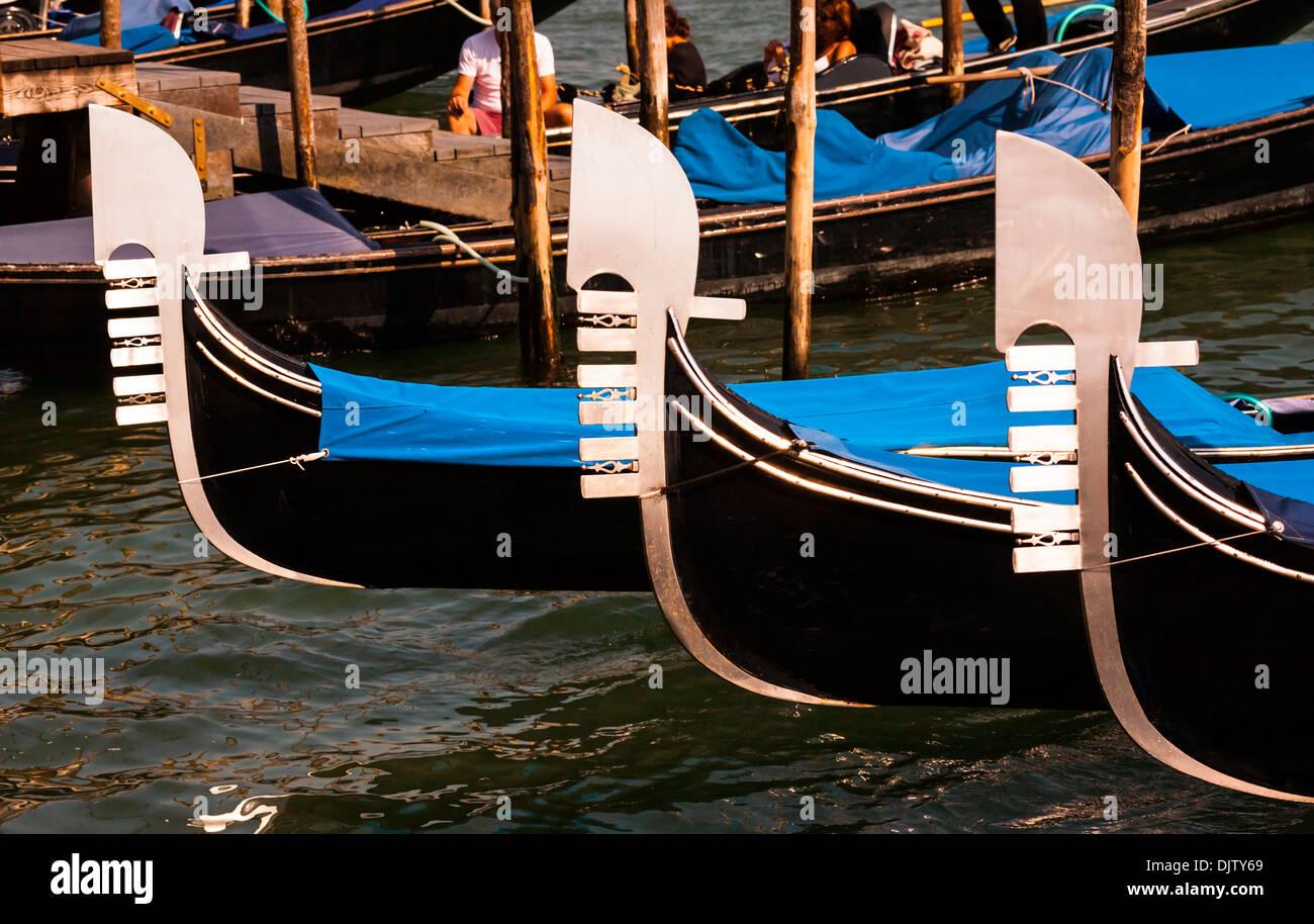 Detail shot of Gondola bows moored on the Grand Canal, Venice, Veneto, Italy. - Stock Image