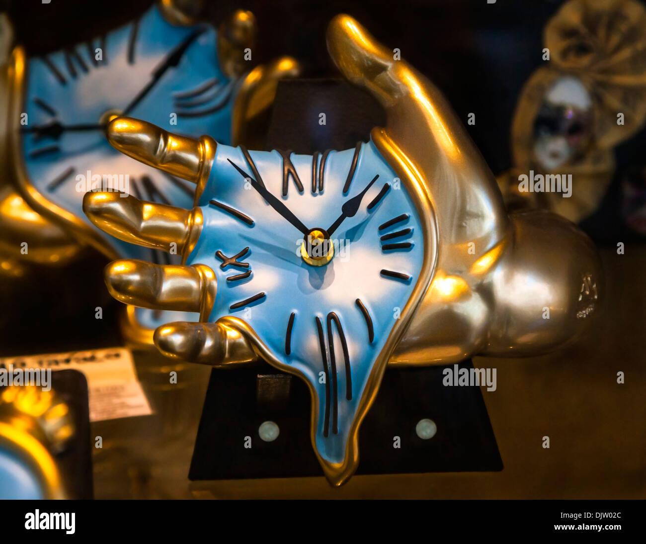 Salvador Dali Melting Clocks Gold Hands holding mel...