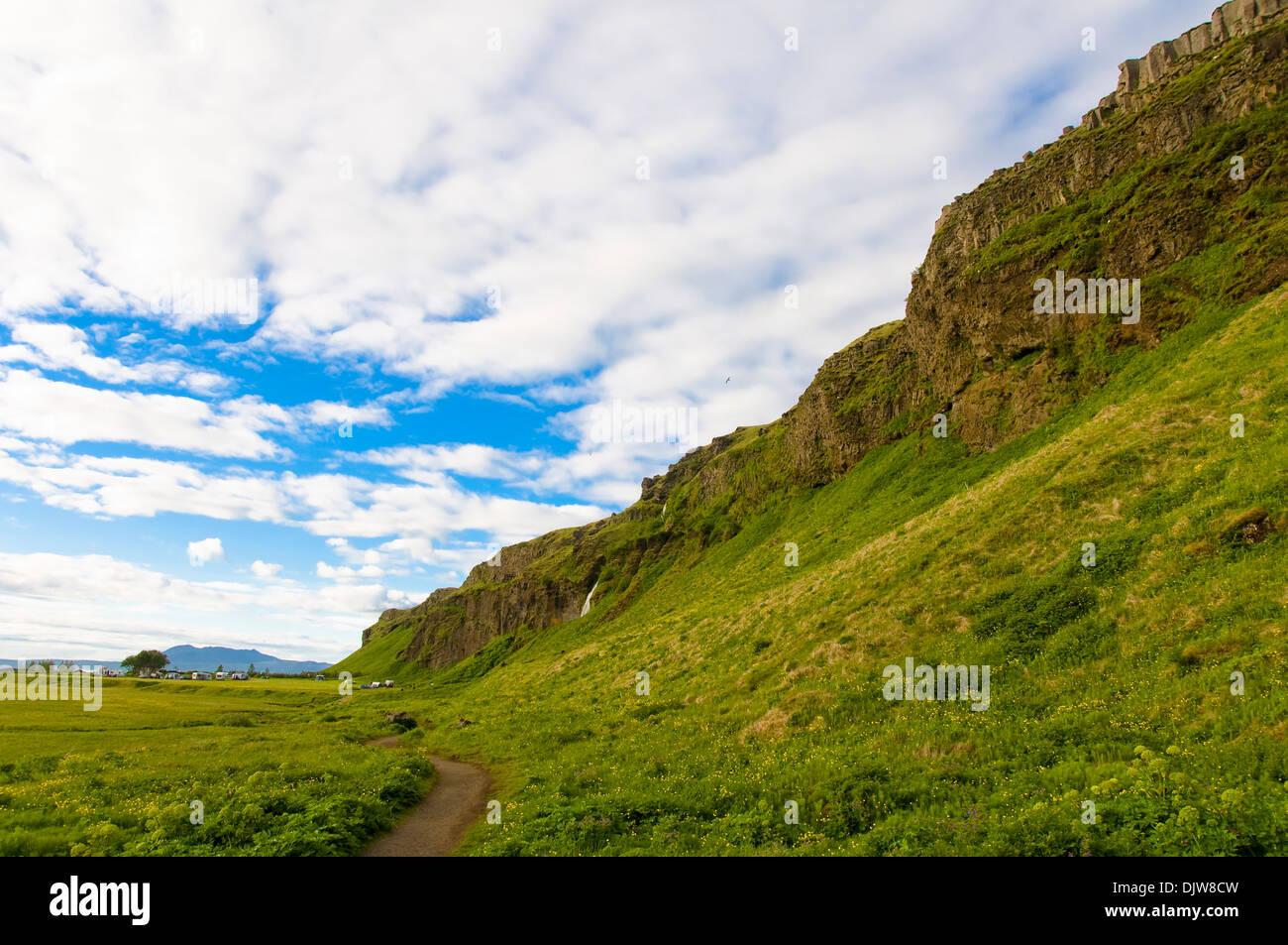 Rocky Scarp, Seljalandsfoss, Iceland - Stock Image