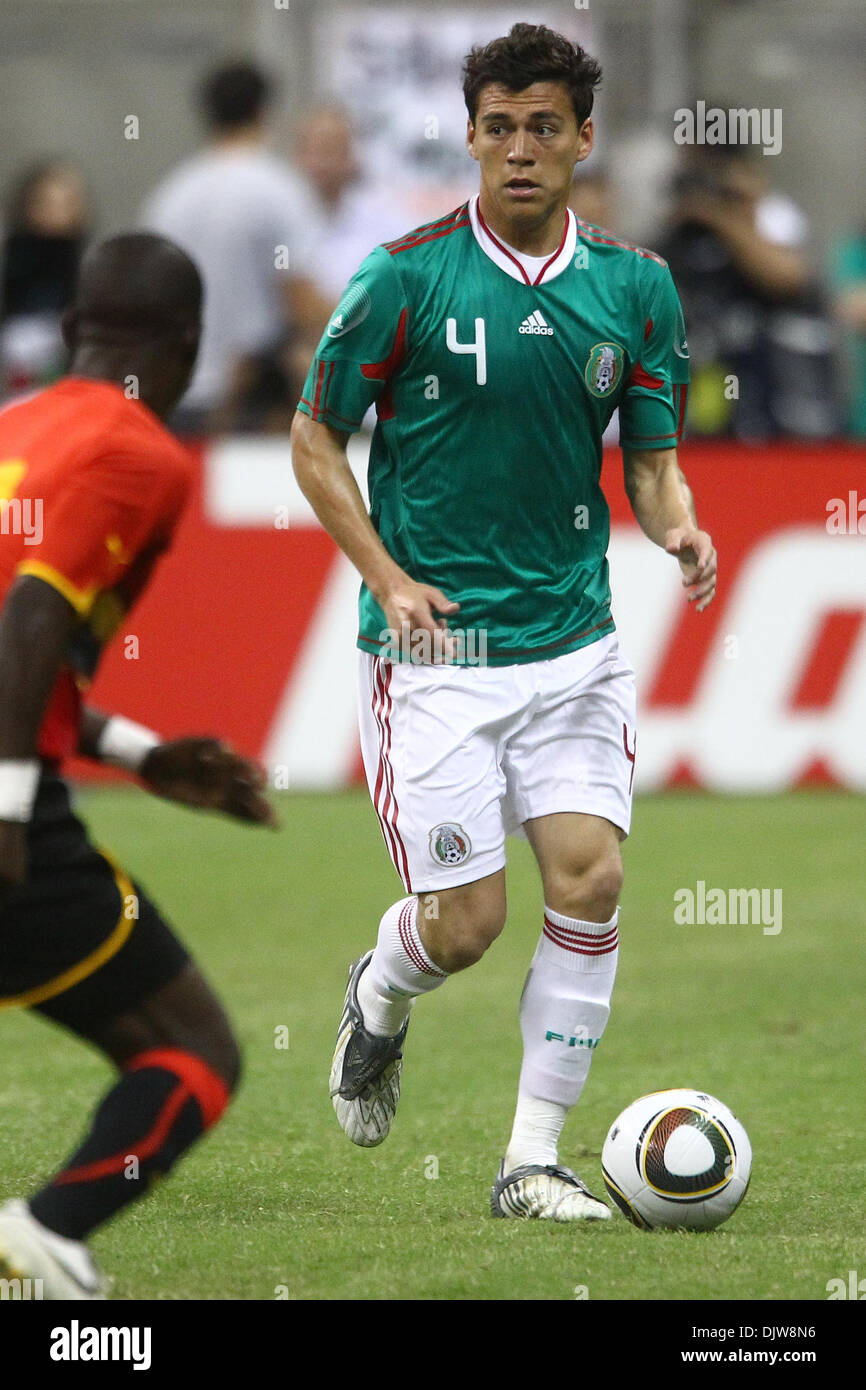 cbcb4d4cd Hector Moreno ( 4) Defender of Mexico dribbles the ball towards Avex ( 11)  Midfielder for Angola. Mexico defeated Angola 1-0 at Reliant Stadium in  Houston