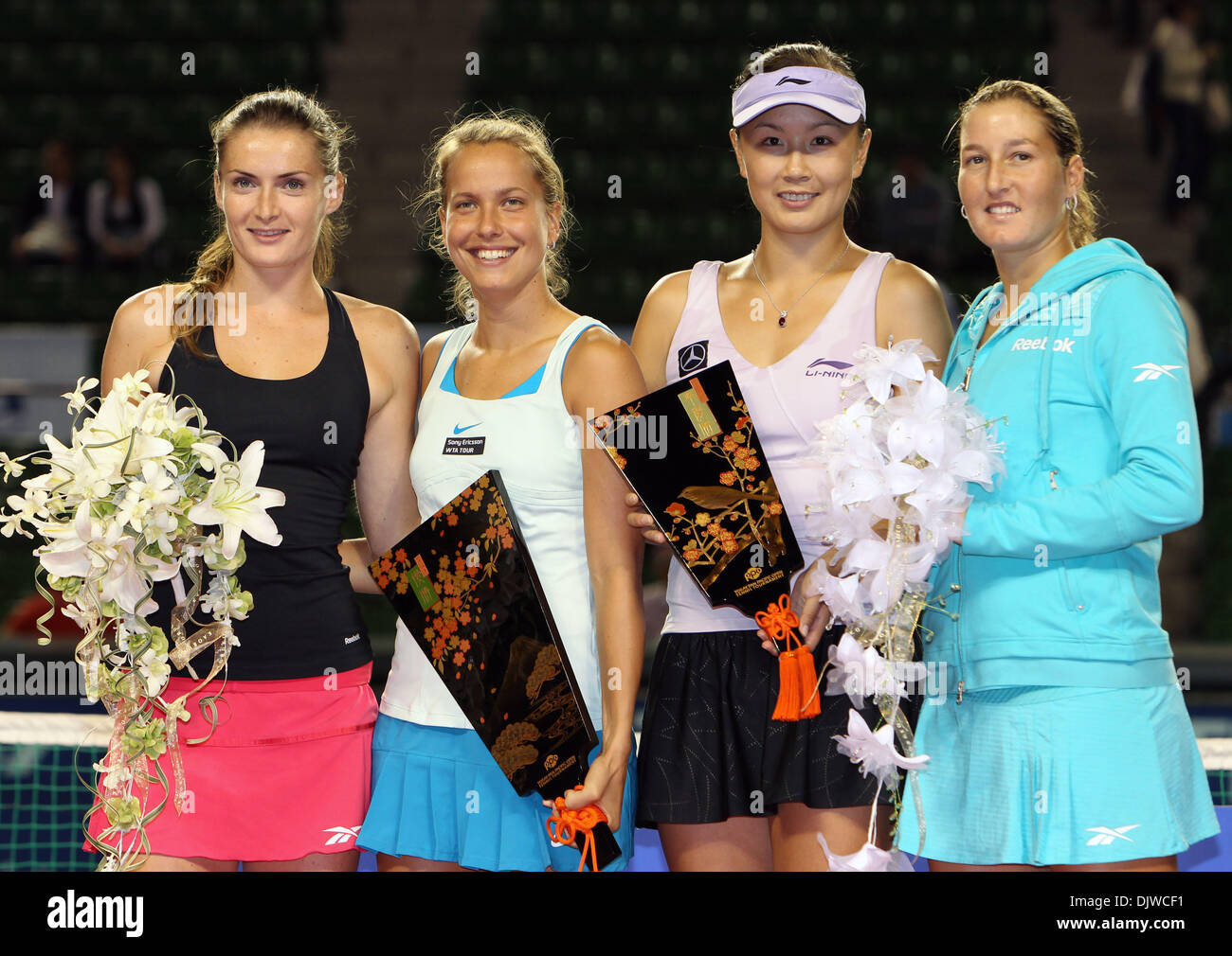 Oct 02, 2010 - Tokyo, Japan -  (L to R) WInners of the Doubles final IVETA BENESOVA and BARBORA ZAHLAVOVA STRYCOVA of Czech Republic, runner up SHAHAR PEER of Israel and SHUAI PENG of China pose for photographs during the Pan Pacific Open tennis tournament at Ariake Colosseum in Tokyo, Japan. (Credit Image: © Junko Kimura/Jana/ZUMApress.com) - Stock Image
