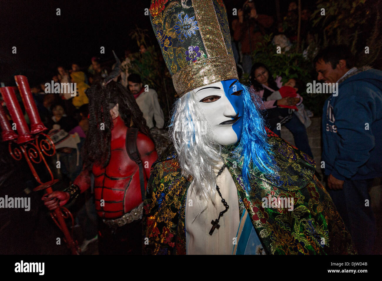 Costumed revelers parade through the streets to celebrate the Day of the Dead Festival known in spanish as Día de Stock Photo
