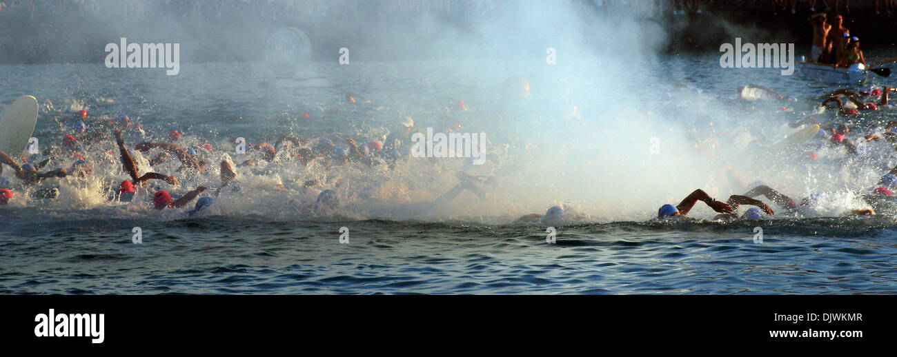 Oct 09, 2010 - Kailua-Kona, Hawaii, U.S. - Triathlon competitors swim through the wafting smoke from the starting cannon at the beginning of the 2010 Ford Ironman World Championship from Kailua-Kona. (Credit Image: © L.E. Baskow/ZUMApress.com) - Stock Image