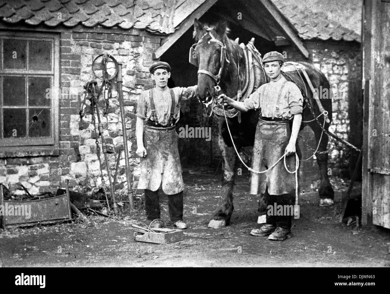 Blacksmith's Shop circa 1910, Thornham, Norfolk, Smithy, Forge, horse, blacksmith, pre 1st World War, Edwardian England, forges, shoeing horses, England UK, archive archival shops - Stock Image