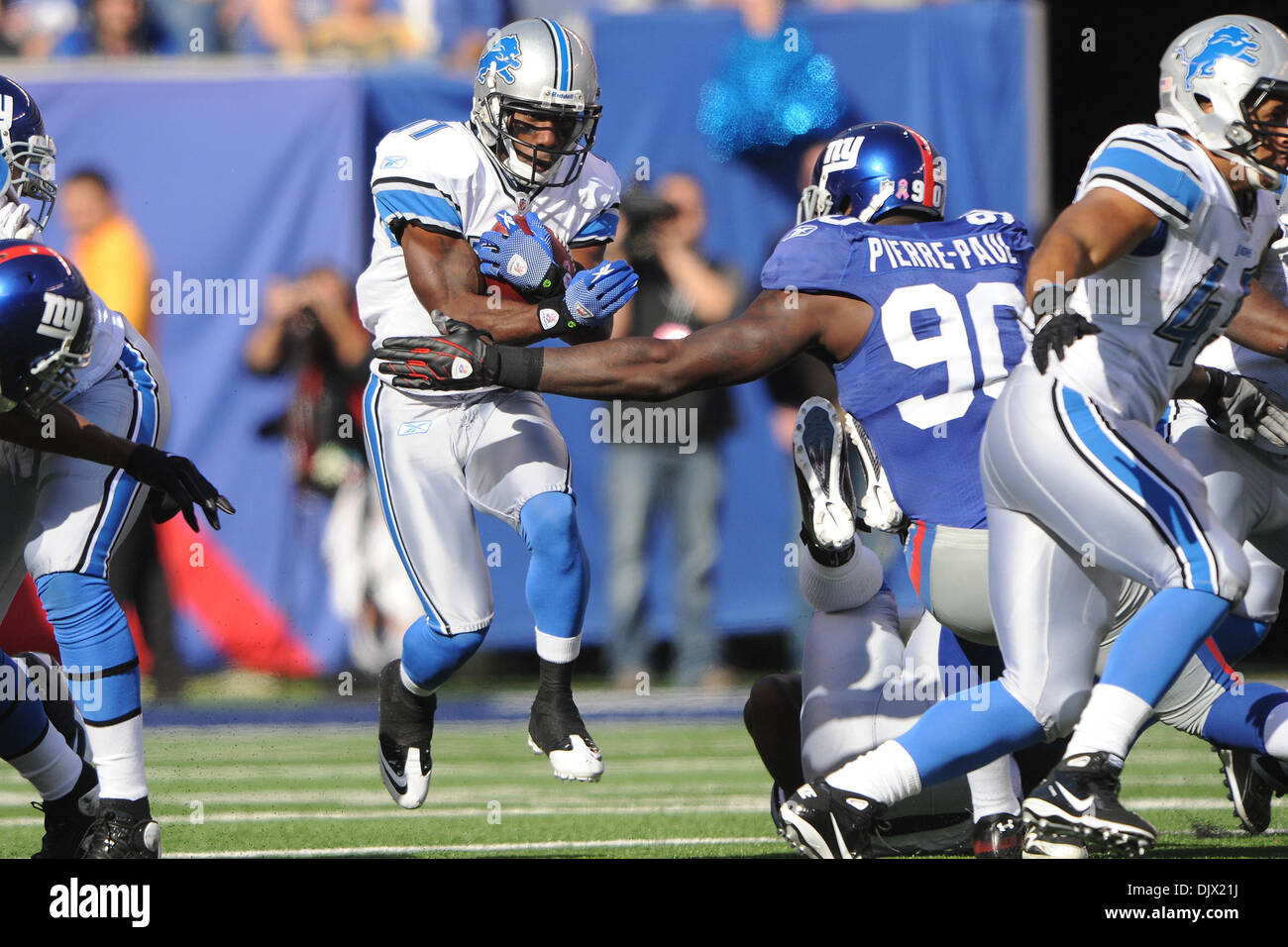 Detroit Lions kick returner Stefan Logan (11) runs through an Stock