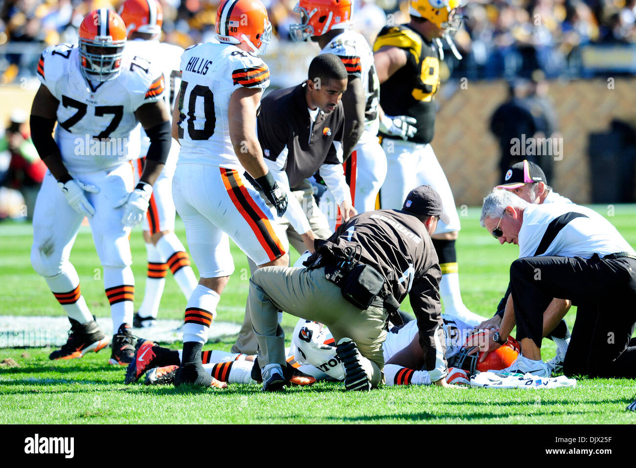 Oct. 17, 2010 - Pittsburgh, Pennsylvania, United States of America - 17 October 2010: Cleveland medical staff attend to Joshua Cribbs (#16) who was knocked out by Steeler LB James Harrison at Heinz Field in Pittsburgh Pennsylvania. Pittsburgh defeats Cleveland 28-10. (Credit Image: © Paul Lindenfelser/Southcreek Global/ZUMApress.com) - Stock Image