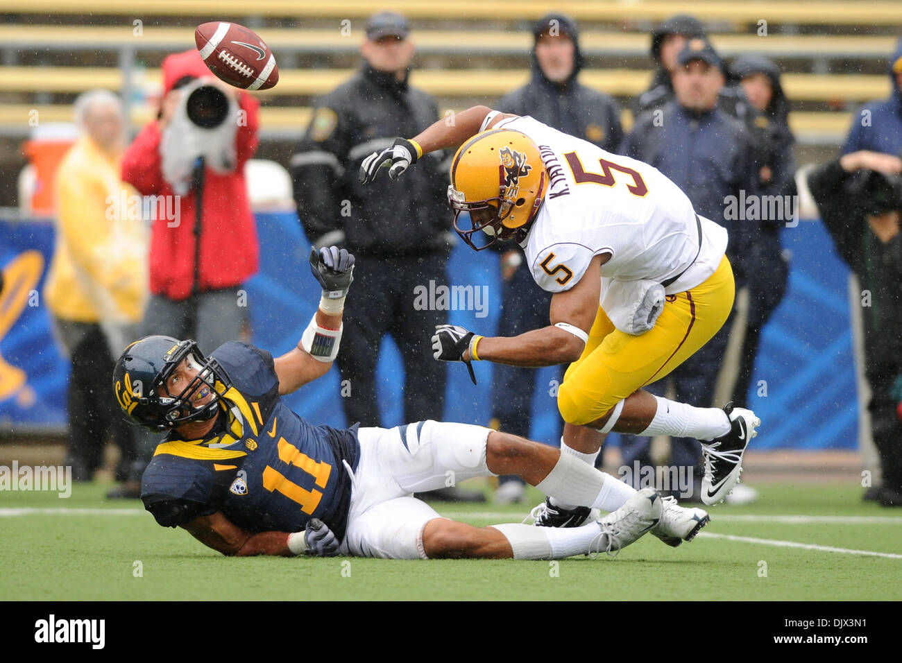 Oct. 23, 2010 - Berkeley, California, United States of America - California Golden Bears cornerback Sean Cattouse (11) watches as a deflection floats harmlessly by Arizona State Sun Devils wide receiver Kerry Taylor (5) during the NCAA game between the California Golden Bears and the Arizona State Sun Devils at Memorial Stadium.  California took the Pac-10 contest 50-17. (Credit Im - Stock Image