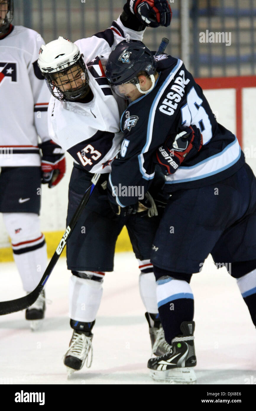 Oct. 29, 2010 - Ann Arbor, Michigan, United States of America - 29 October2010: USA U-17 defenseman Connor Carrick (#43) and Indiana Ice forward Dan Cesarz (#16) get called for roughing. The Indiana Ice beat the USA Under-17 team 6-3. (Credit Image: © Alan Ashley/Southcreek Global/ZUMApress.com) - Stock Image