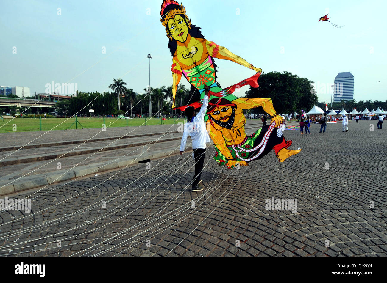 Jakarta, Indonesia. 1st Dec, 2013. A participant flies a kite during the Jakarta International Kite Festival 2013 in Jakarta, Indonesia, Nov. 30, 2013. The two-day festival opened on Saturday, with the participation of 18 countries and regions. Credit:  Agung Kuncahya B./Xinhua/Alamy Live News Stock Photo