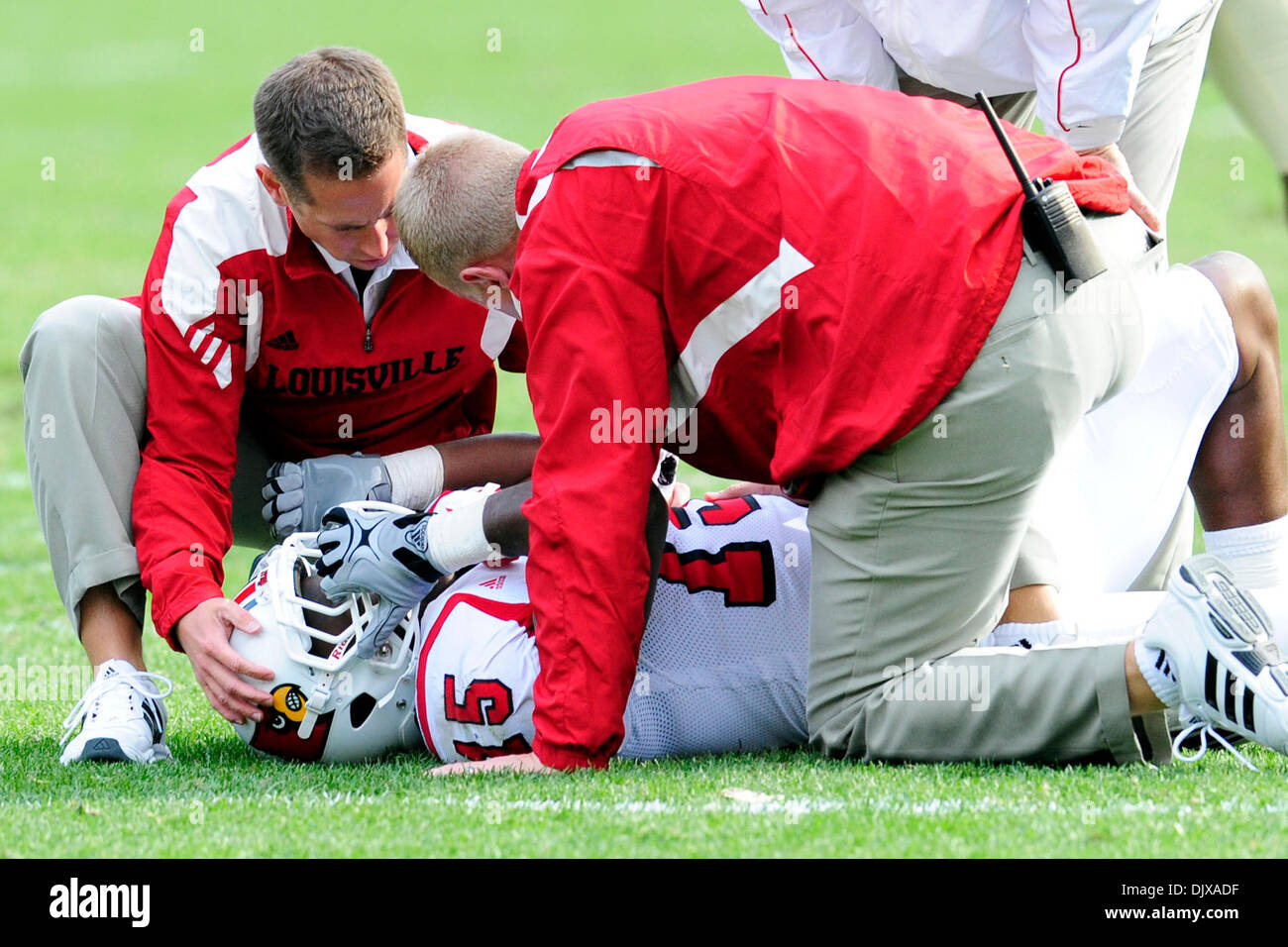 Oct. 30, 2010 - Pittsburgh, Pennsylvania, United States of America - 30 October 2010: Louisville star RB Bi;al Powell (#15) is attended to by the Louisville medical staff after being injured in early second half action at Heinz Field in Pittsburgh Pennsylvania. Pittsburgh defeats Louisville 20-3. (Credit Image: © Paul Lindenfelser/Southcreek Global/ZUMApress.com) - Stock Image