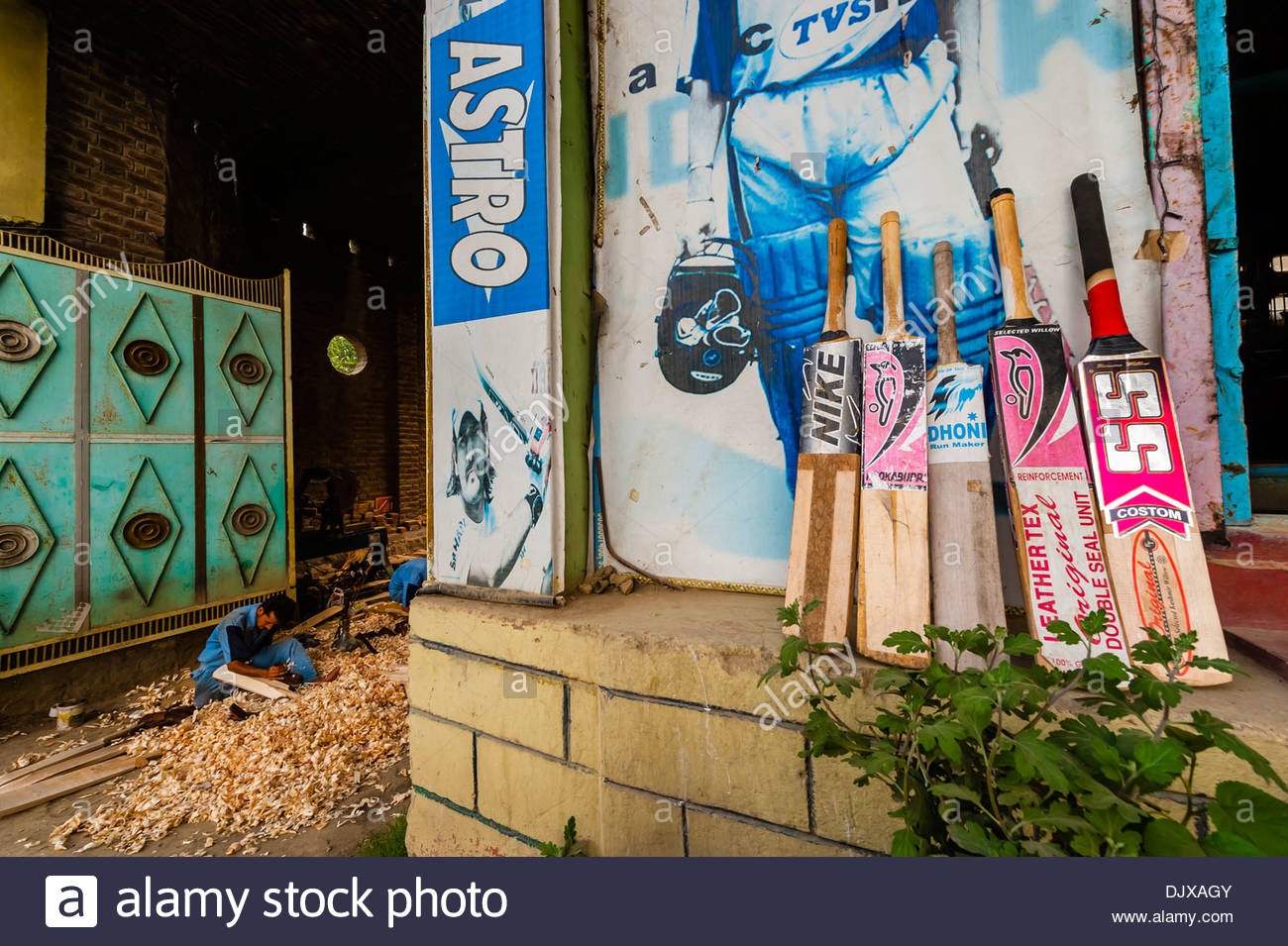 Carving cricket bats by hand at Astro Bat Factory, Kashmir, Jammu and Kashmir State; India. - Stock Image