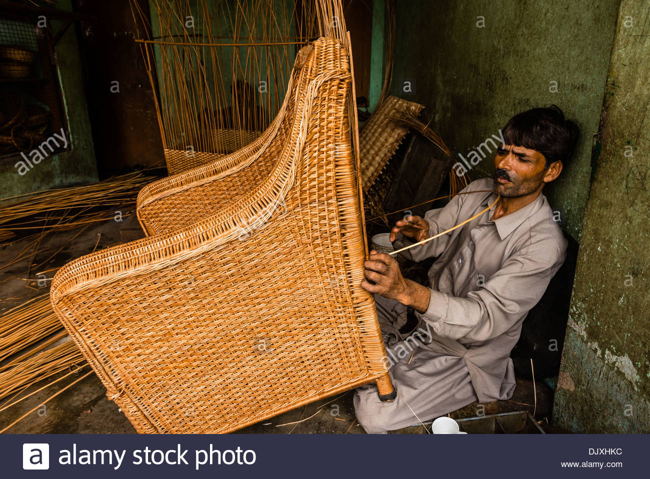 Man making ratan chairs, Srinagar, Kashmir, Jammu and Kashmir State; India. - Stock Image
