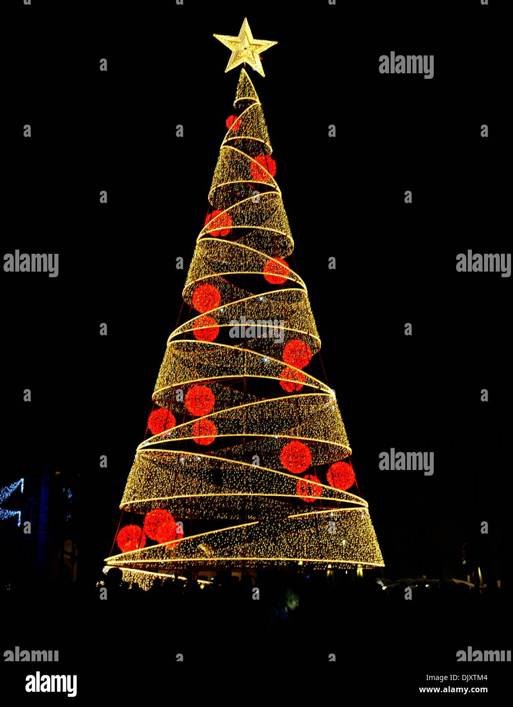 Lisbon, Portugal. 1st Dec, 2013. A huge Christmas Tree is lighted up in central Lisbon, Portugal, on Nov. 30, 2013. © Zhang Liyun/Xinhua/Alamy Live News - Stock Image