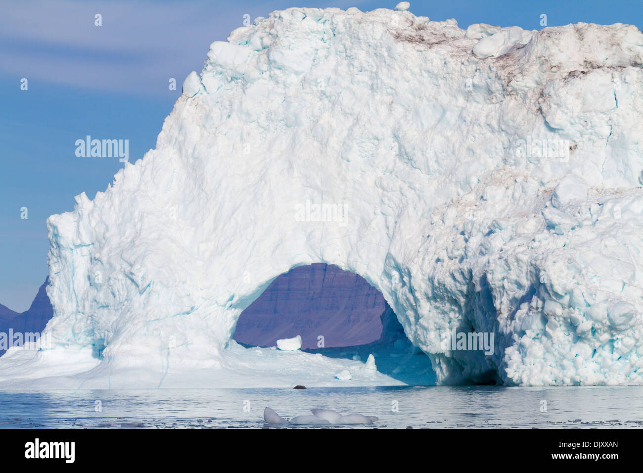 Ice arch on huge iceberg, Fohnfjord, Greenland - Stock Image
