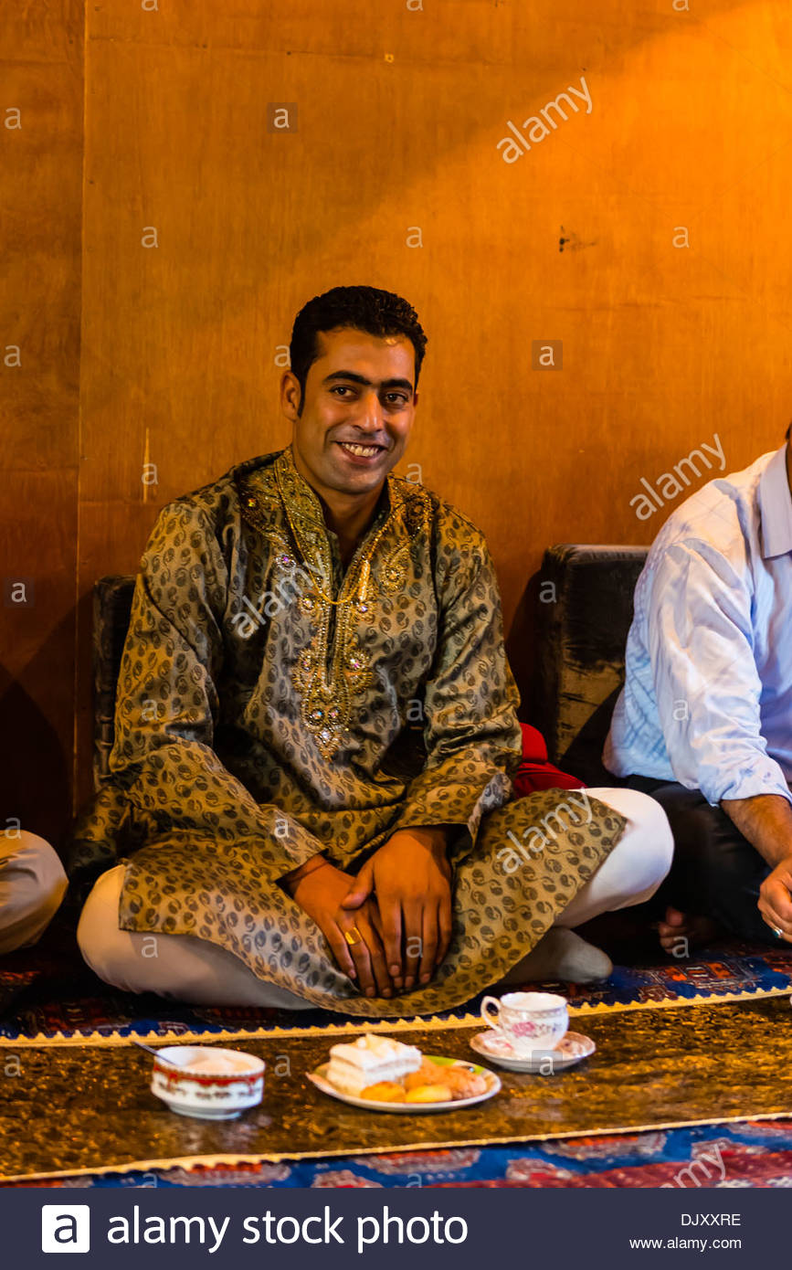 A Muslim engagement party where the bride and grooms families meet, in a houseboat on Dal Lake, Srinagar, Kashmir, Stock Photo