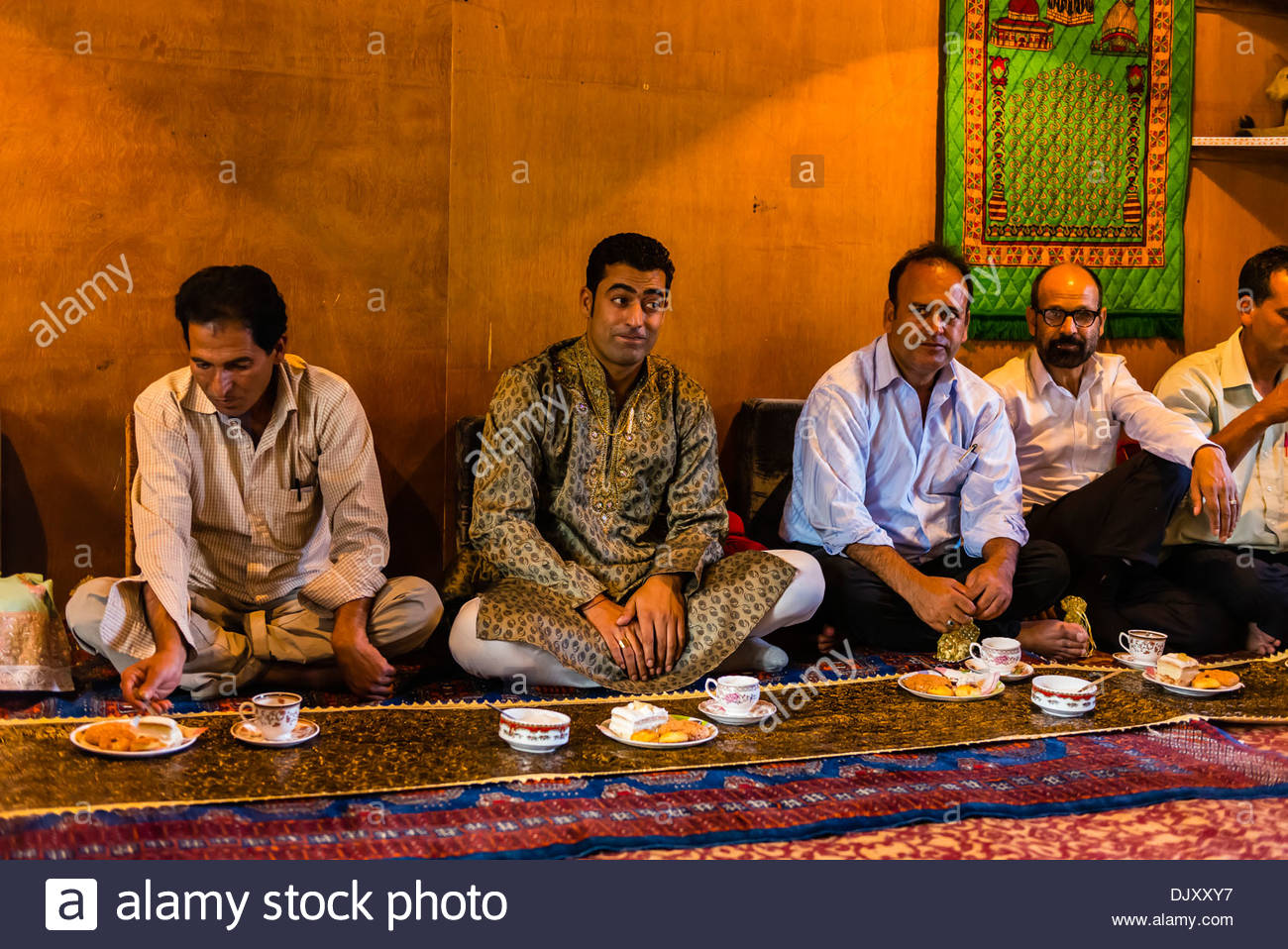 A Muslim engagement party where the bride and grooms families meet, in a houseboat on Dal Lake, Srinagar, Kashmir, Jammu and Kashmir State; India. - Stock Image