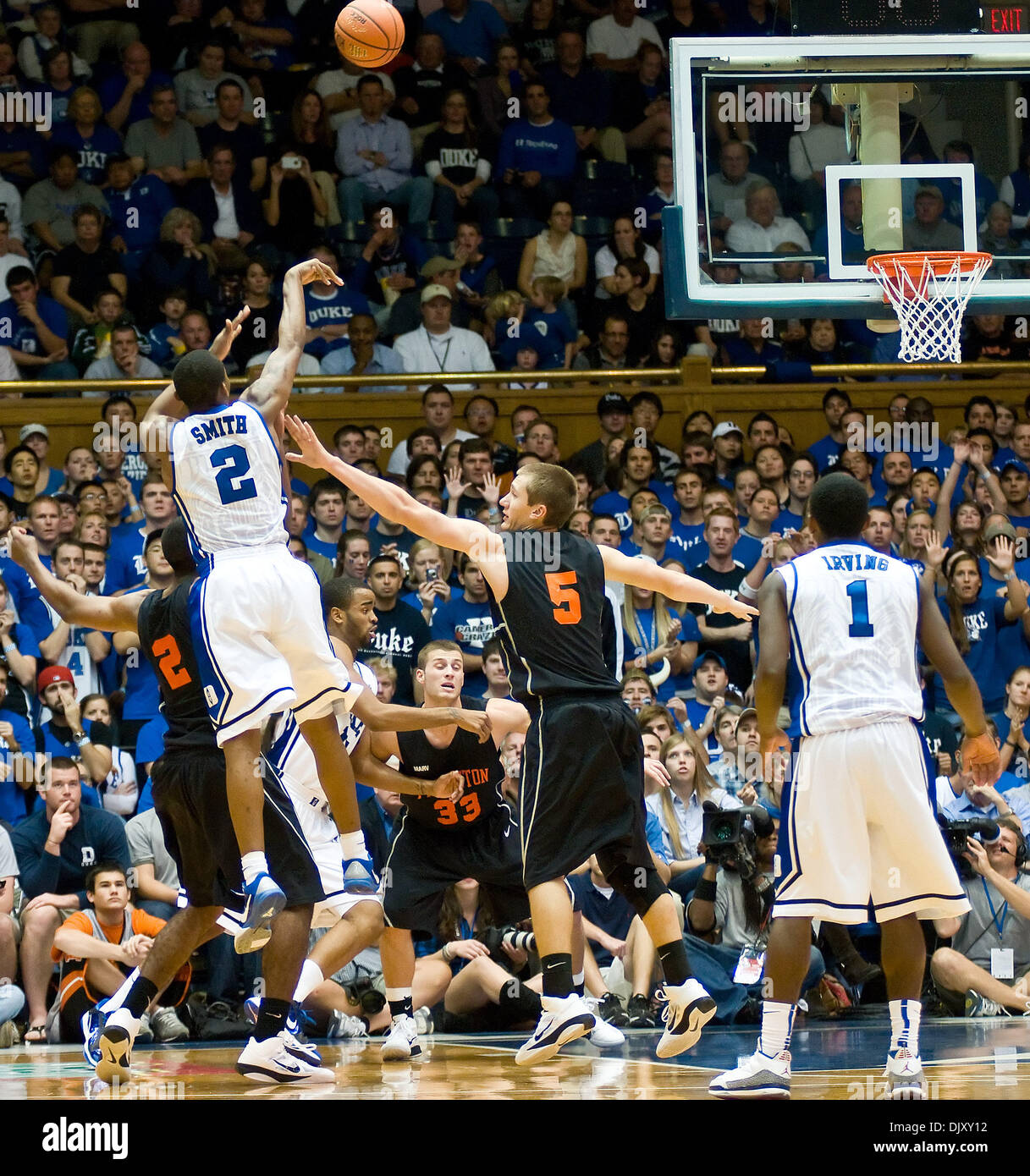 Nov. 14, 2010 - Durham, North Carolina, United States of America - Duke Blue Devils guard Nolan Smith (2) shoots a 3pointer over Princeton Tigers guard T.J. Bray (5).Duke beats Princeton 97-60 at Cameron Indoor Stadium Durham NC (Credit Image: © Mark Abbott/Southcreek Global/ZUMApress.com) - Stock Image
