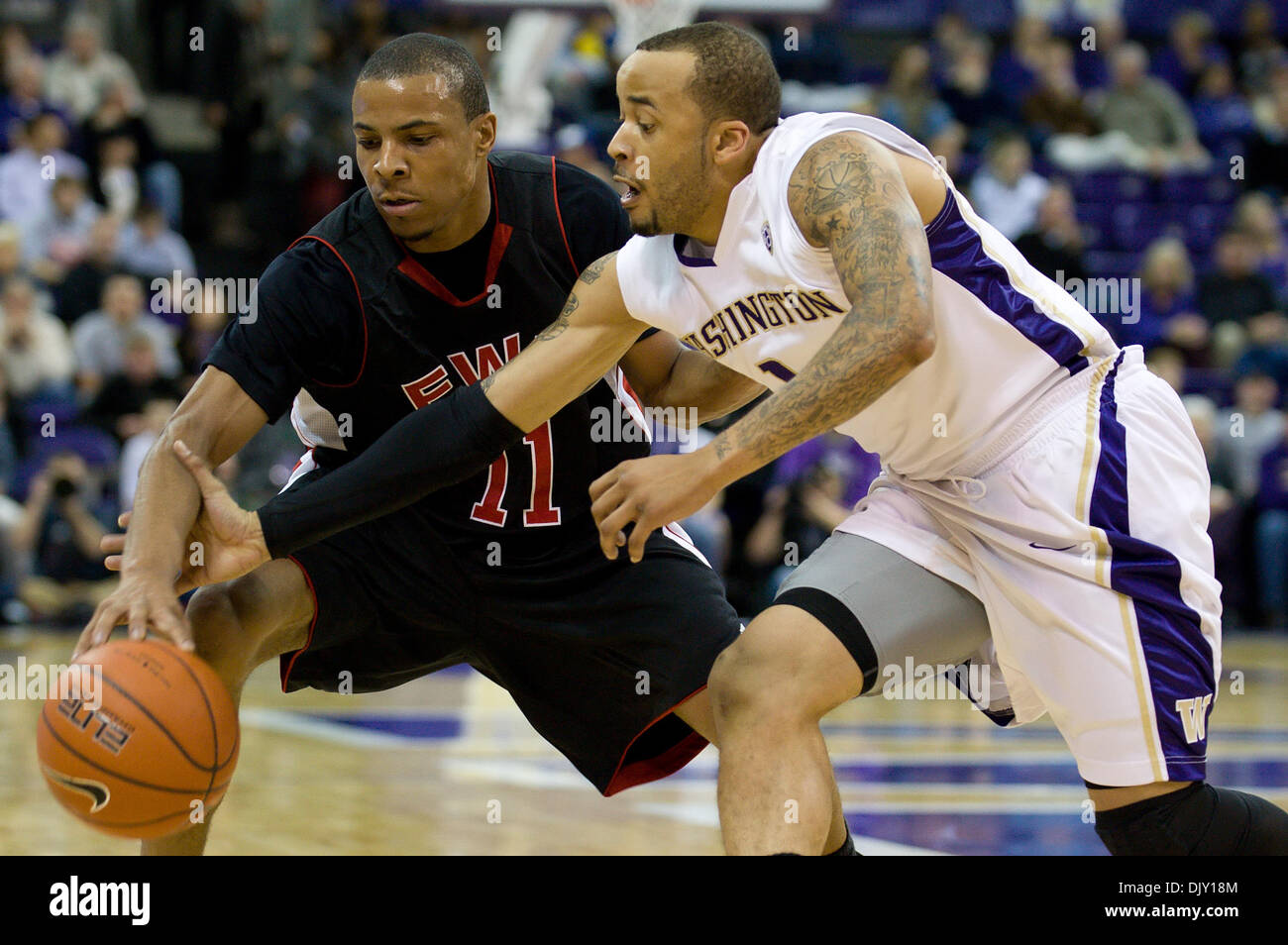 Nov. 16, 2010 - Seattle, Washington, United States of America - Washington Huskies guard Venoy Overton (1) steals the ball from Eastern Washington Eagles guard Cliff Colimon (11) during the game between Eastern Washington and the University of Washington at Bank of America Arena in Seattle, WA. University of Washington leads Eastern Washington 42-34 at the half. (Credit Image: © St - Stock Image