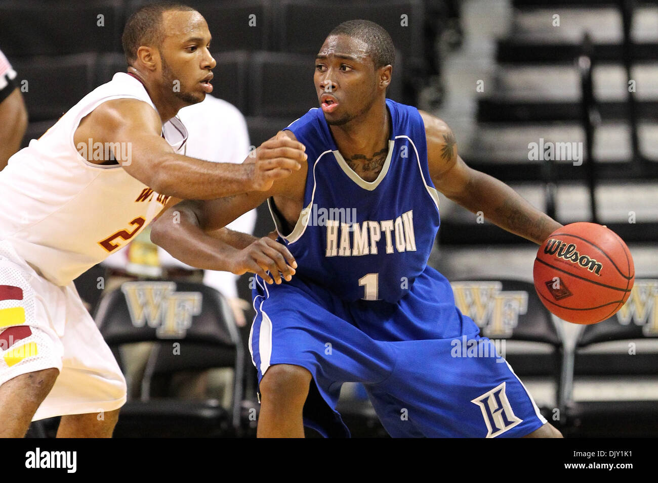 Nov. 16, 2010 - Winston-Salem, North Carolina, United States of America - Hampton Pirates guard Darrion Pellum (1) drives on Winthrop Eagles guard Gideon Gamble (2). Half Time score Hampton 23- Winthrop 16 (Credit Image: © Jim Dedmon/Southcreek Global/ZUMApress.com) - Stock Image