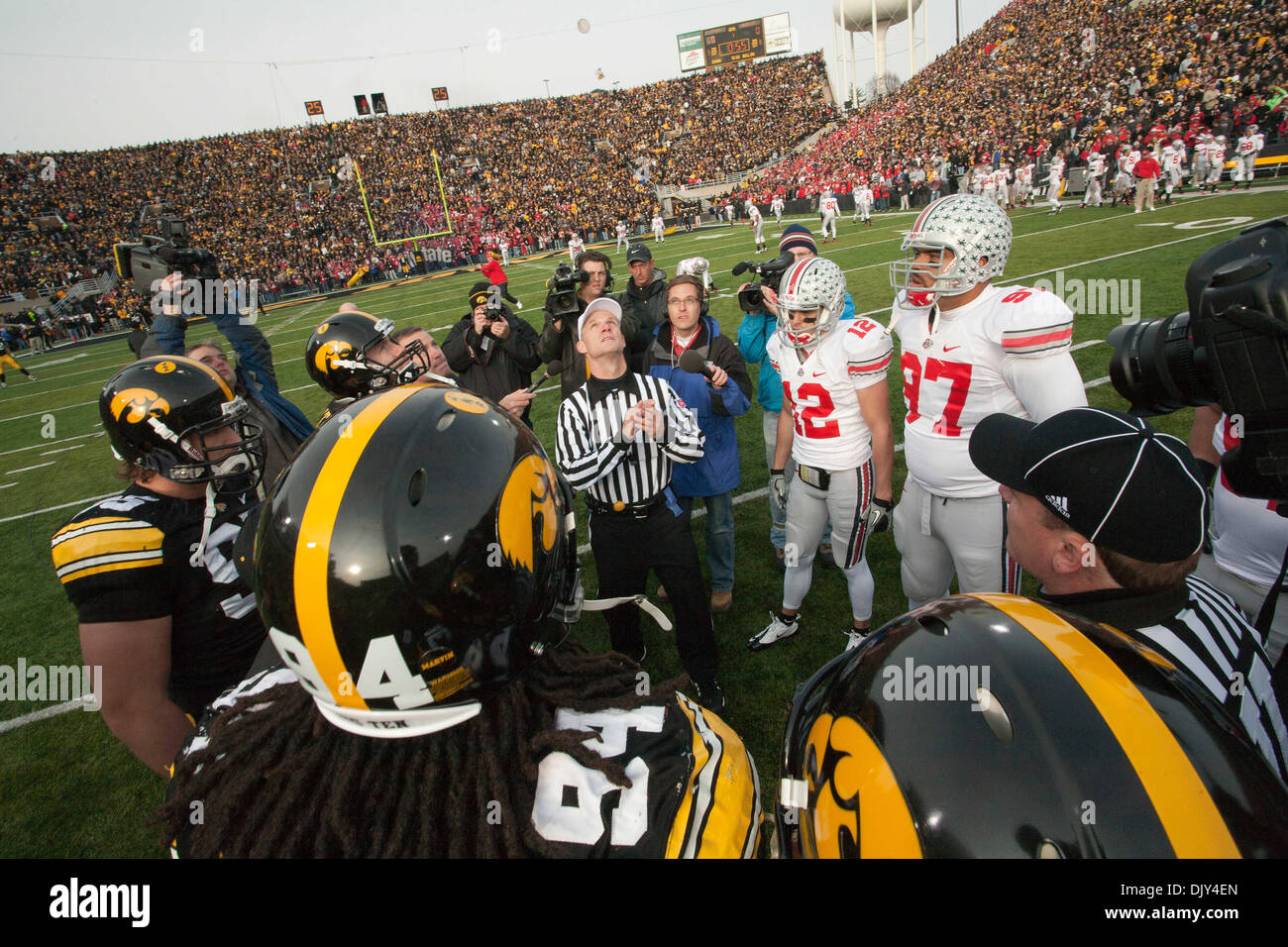 Nov. 20, 2010 - Iowa City, Iowa, United States of America - The captains of the Iowa Hawkeyes and Ohio State Buckeyes look on during the coin flip just prior to kick off of their NCAA Football game on Nov, 20, 2010 at Kinnick Stadium in Iowa, City, Ia (Credit Image: © Louis Brems/Southcreek Global/ZUMAPRESS.com) - Stock Image