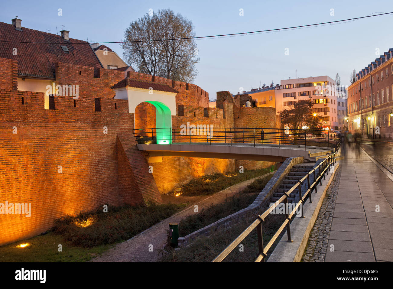 Illuminated Old Town fortified wall at twilight in Warsaw, Poland. - Stock Image