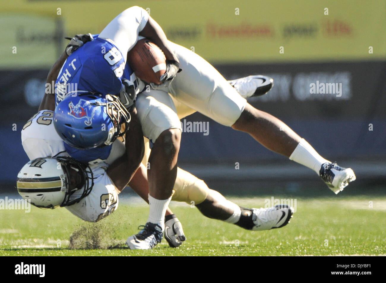 Nov. 27, 2010 - Memphis, Tennessee, United States of America - UCF Knights cornerback Emery Allen (22) pulls down Memphis Tigers running back Marquez Allen (48) during the NCAA regular season game between the UCF Knights at Memphis Tigers at the Liberty Bowl Memorial Stadium. UCF Knights defeat the Memphis Tigers 37 - 17 final. (Credit Image: © Danny Reise/Southcreek Global/ZUMAPRE - Stock Image