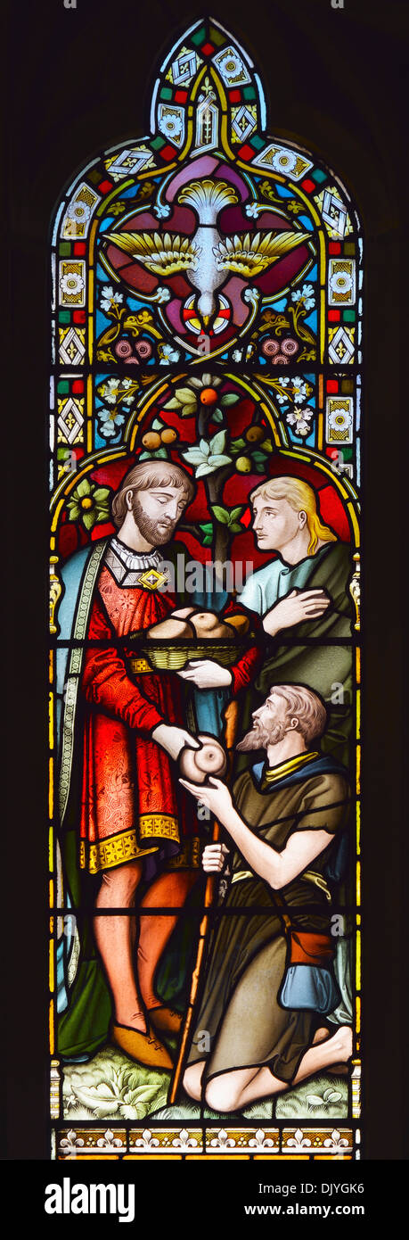Giving to the needy. Detail of South aisle East window. Church of Saint Paul, Grange-over-Sands, Cumbria, England, U.K., Europe - Stock Image