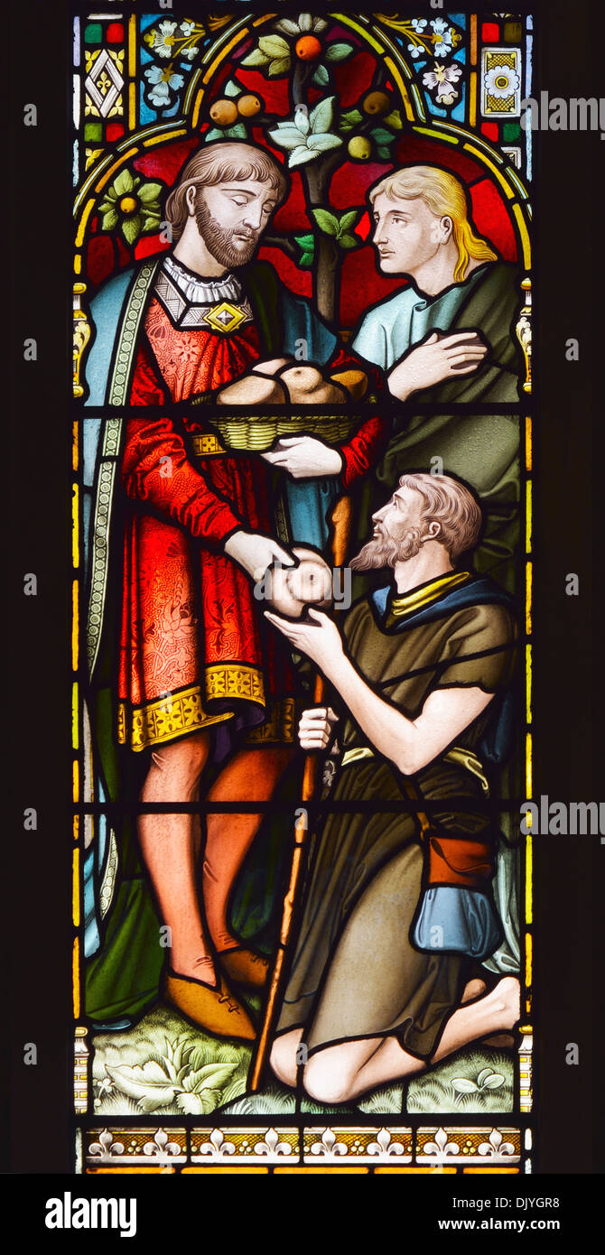 Giving to the needy. Detail of South aisle East window. Church of Saint Paul, Grange-over-Sands, Cumbria, England, U.K., Europe. - Stock Image