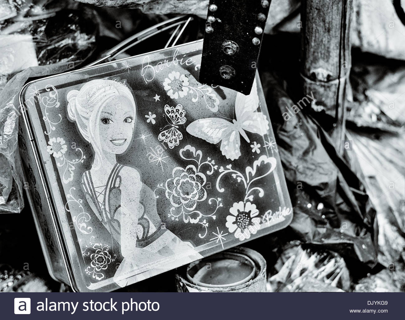 A Barbie metal tin box inside a dilapidated wooden house in the Sathorn district of Bangkok, Thailand - Stock Image