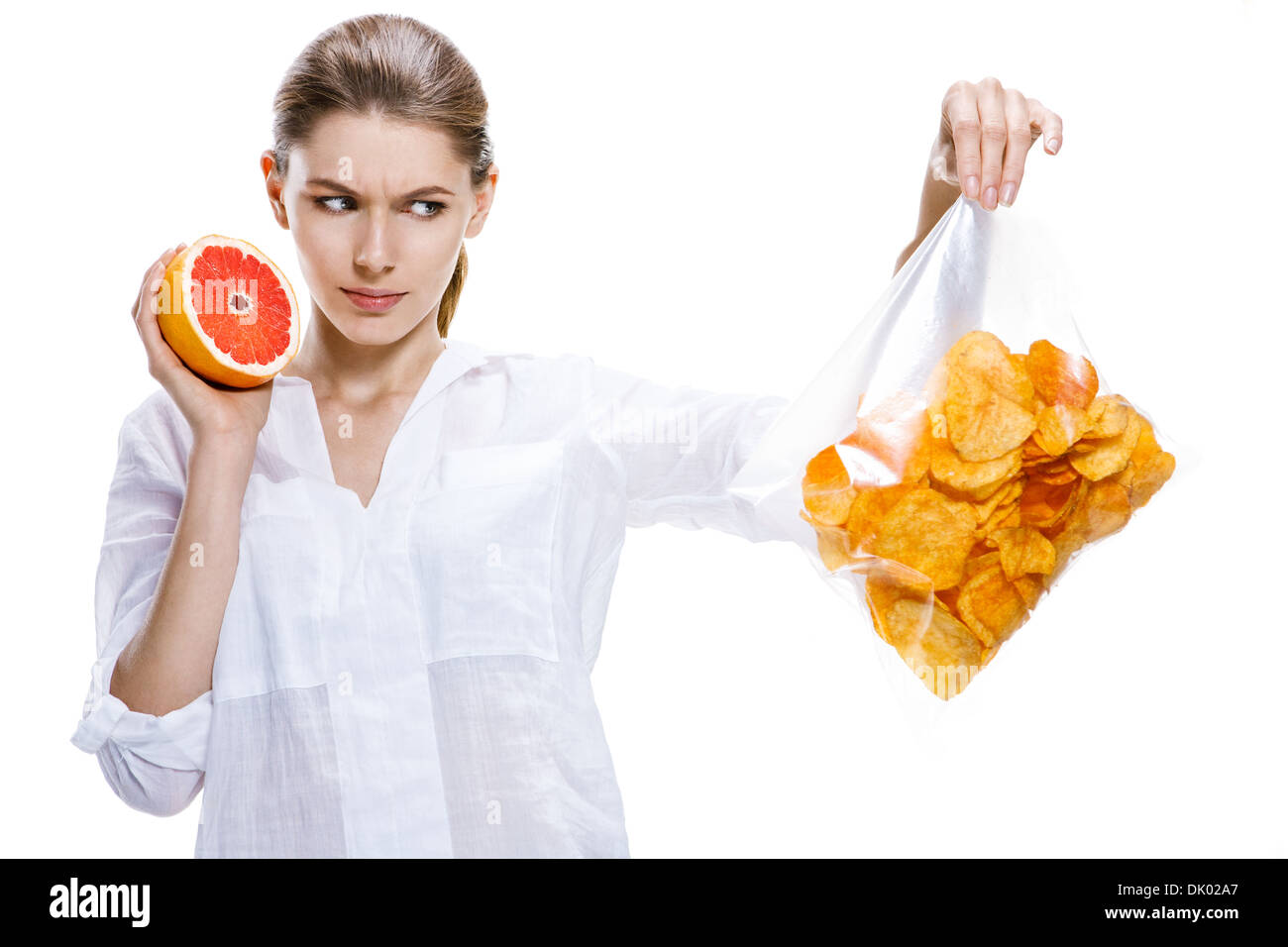 Healthy brunettes against the chips - isolated on white background - Stock Image
