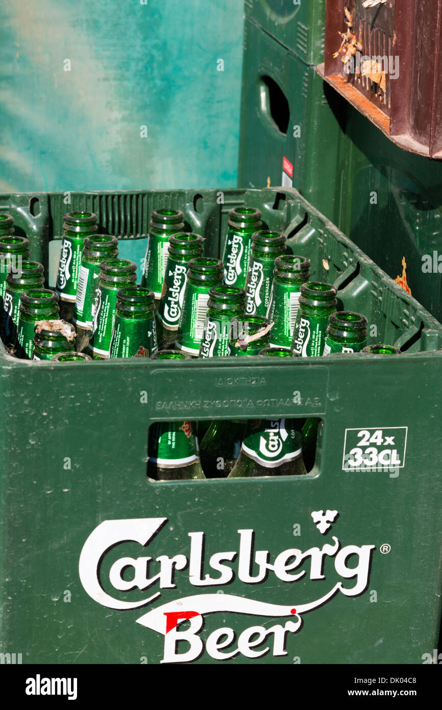 Crate full of empty Carlsberg beer bottles. Cyprus. - Stock Image