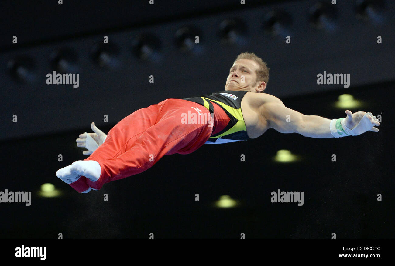 Stuttgart, Germany. 1st Dec 2013.Germany's Fabian Hambuechen at the high bar during the Gymnastics World Cup. Hambuechen was second placed.  Credit:  dpa picture alliance/Alamy Live News - Stock Image