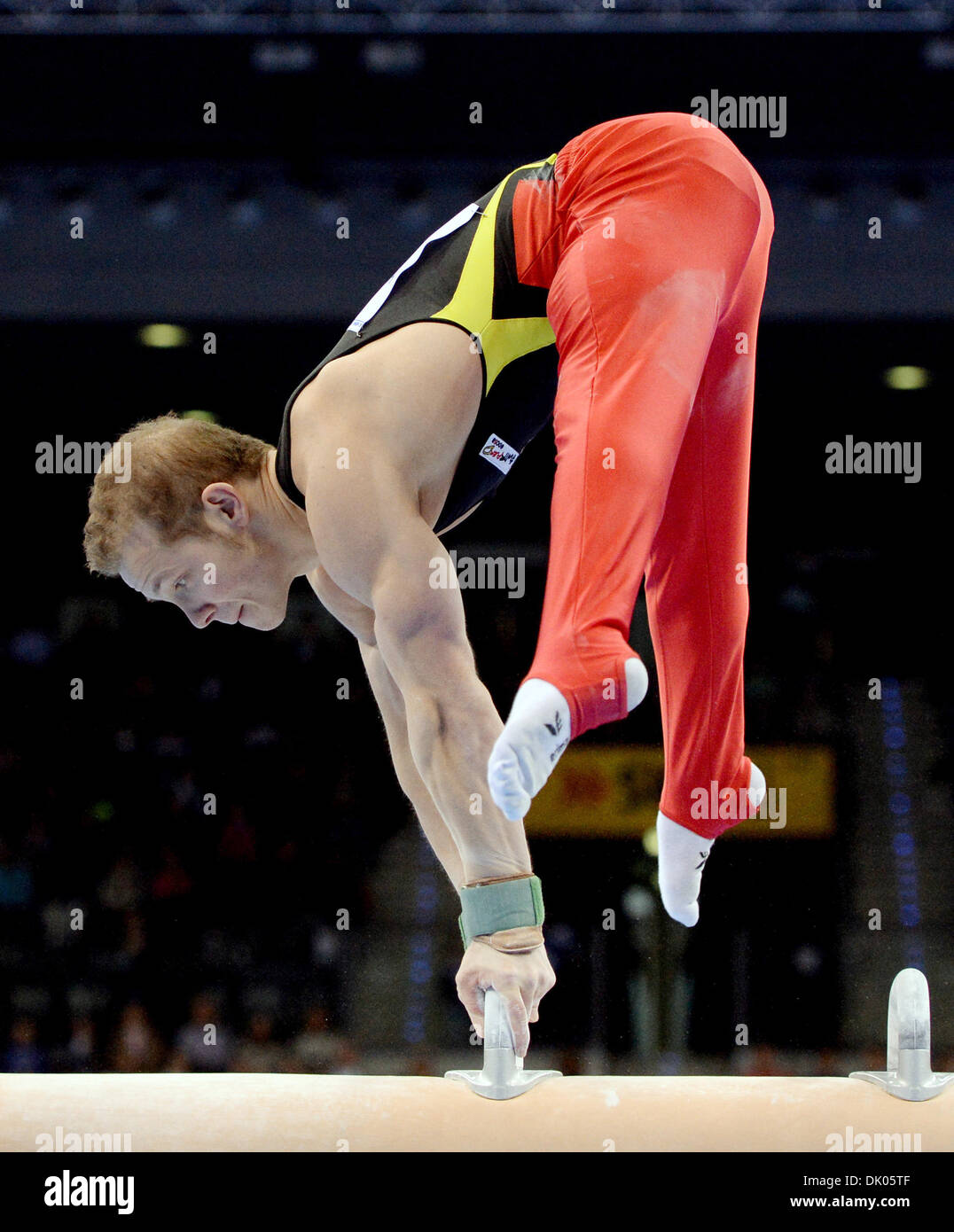 Stuttgart, Germany. 1st Dec 2013.Germany's Fabian Hambuechen at the pommel horse during the Gymnastics World Cup. Stock Photo